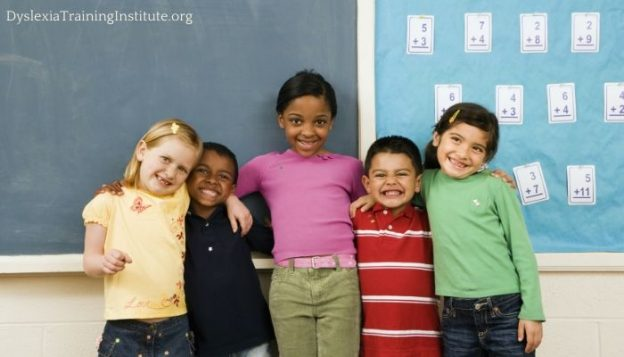 Dyslexia and Diversity: Where is the Diversity? (Image features a Group of children standing in front of a blackboard.)